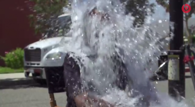 Beats cofounder Dr. Dre accepts Apple CEO Tim Cook's ALS 'ice bucket challenge'
