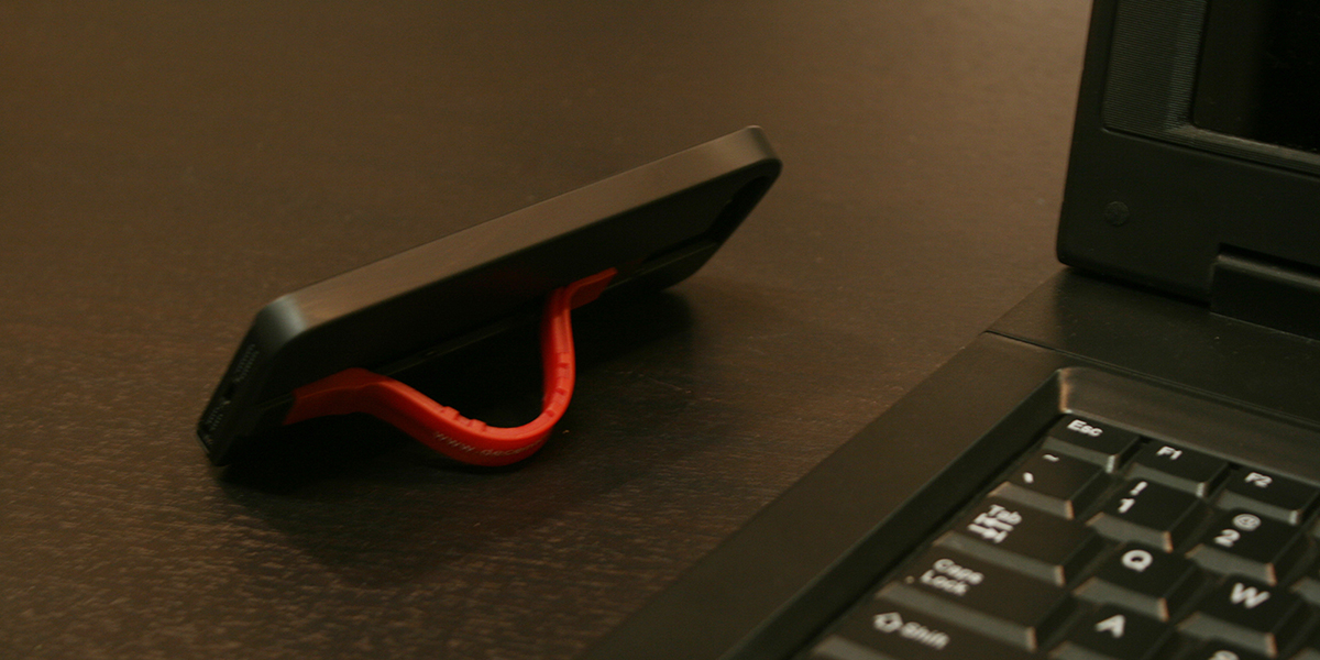 Apple Worm Case For iPhone Hides A Lightning Cable, But Doubles As A Stand