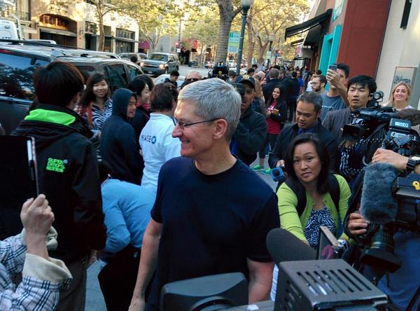 Tim Cook celebrates the release of the iPhone 6 and iPhone 6 Plus