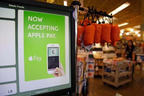 Apple Pay seeing significant adoption at retailers like Whole Foods and McDonald's