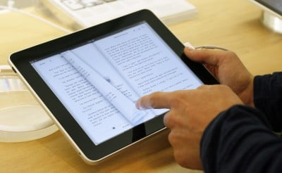 Apple begins appeal of e-book ruling, $450 million in fines on the line