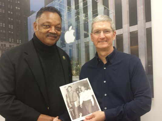 Apple CEO Tim Cook talks with civil rights leader Jesse Jackson about diversity in tech