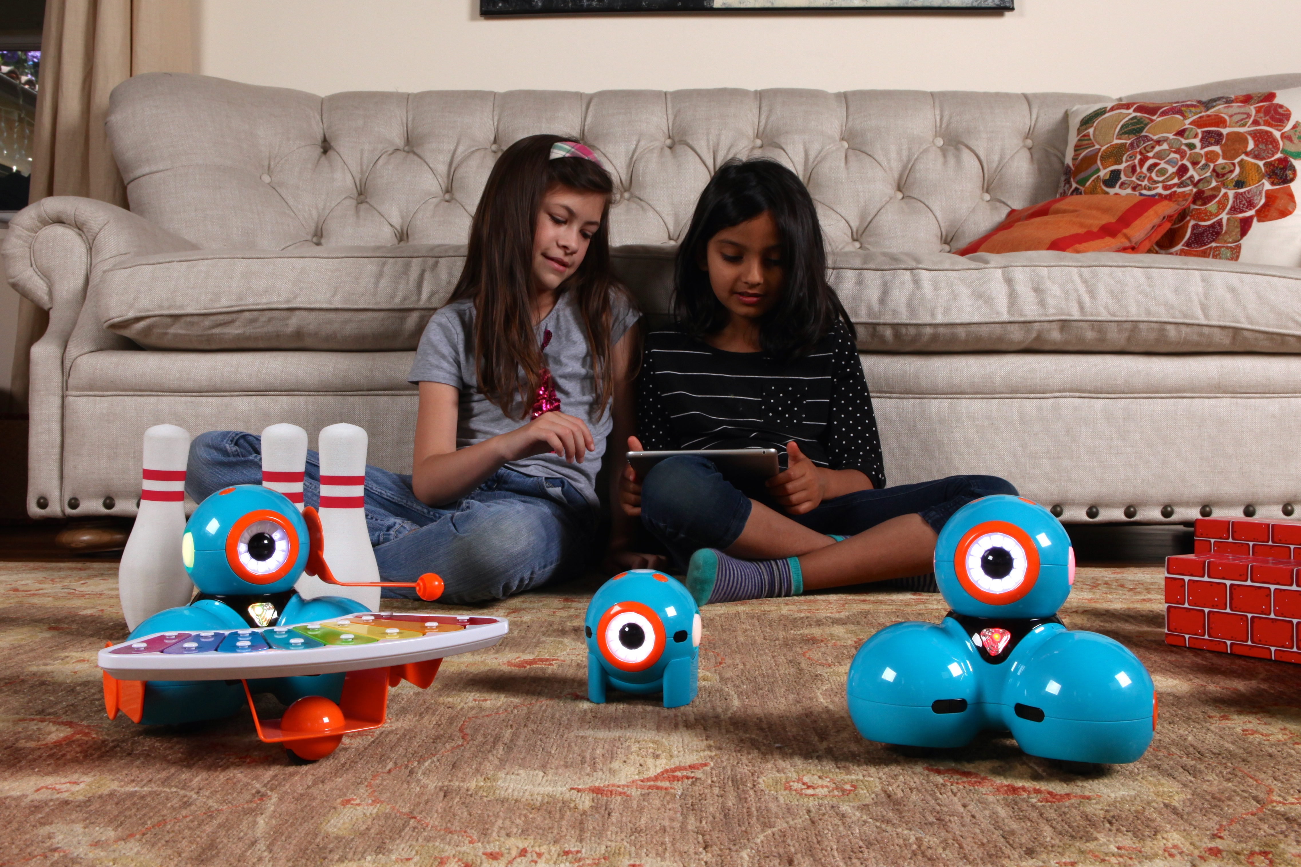 Girls, ages 8 and 9 playing with Dash & Dot
