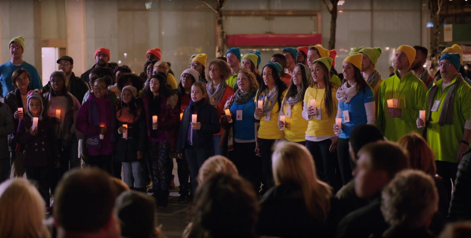 Microsoft employees spread some Christmas cheer by caroling - outside an Apple Store